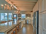 Decorative lighting, brand new appliances and a huge island provide the perfect home-cooking experience in the fully...