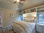 The beautiful master bedroom boasts a plush king bed, flat-screen TV and an en-suite bathroom.