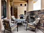 Spacious Balcony with Patio Furniture and Fireplace