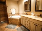 Master Bathroom with Double Sinks, Jetted Tub, and Walk In Showe