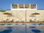 Relax in the sun deck of Villa Irida and enjoy the stunning sea view