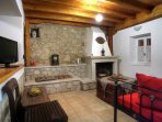 Traditional living room of Villa Menelia with fireplace
