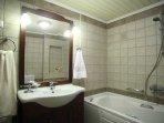 Bathroom with jacuzzi bathtub