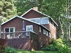 Port View Cottage has 2 bedrooms and 2 bunk rooms, and 2 full baths