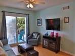 Sunchase 111 - Another view of Living area; sliding door opens to outdoor seating on breezeway