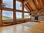 Grand Room fireplace, cougar, and genuine 18 foot log canoe.