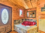 Relax with a soak in the heart-shaped jacuzzi.
