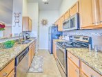 The fully equipped kitchen has granite counter tops and stainless steel appliances.