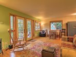 The cozy interior features beautiful hardwood floors throughout the main living space.