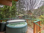 Relax in the 3-person hot tub and enjoy the soothing sound of the river in the background.