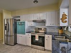 The kitchen comes fully equipped and boasts stainless steel appliances.