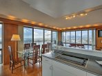 Gather around the elegant 6-person dining table to dine with a view.