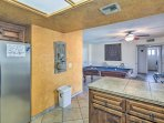 When it's time for dinner, head into the fully equipped kitchen located just steps from the pool table.