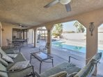 Enjoy the fresh air on the shaded furnished patio.