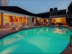 The Solar heated pool at Dusk recliners Candle lights around the Pool warm water cold Beer Relax