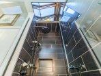 skylight in guest bath rain shower