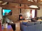 Upstairs living area/ games room with log burning stove