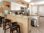High-end stainless appliances in the fully stocked kitchen