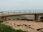 The bridge over the river just north along the footpath at Longhoughton Beach