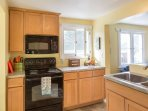 The spacious kitchen has everything you need to make your own home cooked meals.