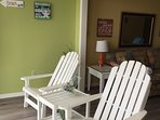 Comfy Adirondack chairs, 1 rocker, 1 child's chair, to enjoy dolphin watching!