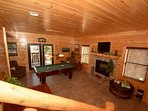 Lower level features pool table, fireplace and table with 4 chairs for board game time.
