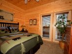Downstairs queen size bedroom with private access to balcony and flatscreen TV.
