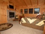 Master King size bedroom suite with cozy fireplace, flatscreen TV and in-room Jacuzzi tub and private bath.