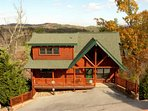 Pine Cone Lodge with parking for 4 cars, park style charcoal grill available for grilling out.
