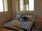 double bedroom window has sea views