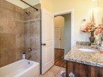Shared bathroom. tub/shower combination