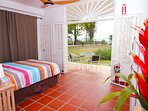 Downstairs unit with queen bed. Cable TV unit included after pciture was taken. Great seaview