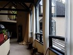 The view walking from front entrance through Executive lounge to Turret Dining room.
