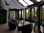 Open Conservatory onto deck and swimming pool.
