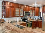Custom full service Kitchen.  Granite counters with cherry cabinets and SS appliances.
