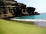 Green sand beach near south point.  Requires a 5 mile round trip walk.  Sand has neat greenish tint.