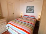 Upstairs bedroom '2: Doublebed. This room opens onto te veranda for beautiful view of the sea