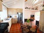 Modern, open plan kitchen area, adjoining living room