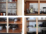 Cookware, dishware, glassware and various kitchen accessories and appliances are provided.