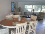One of a few dinning tables, right off pool area with patio doors that stack open to open air.