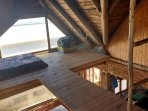 Side attic which has glimpses of the ocean with walkway.