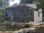 Screened porch overlooks private meadow, great for morning coffee or afternoon glass of wine.
