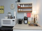 The kitchenette, has fridge/freezer, microwave, toaster, 2 coffee makers(Keurig and standard.