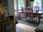 There's a spacious freezer /refrigerator in the kitchen and dinner table for 6.