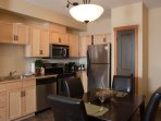 The fully-equipped kitchen contains modern appliances and wood touches