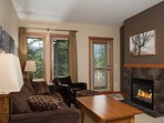 Warm up in front of the stunning stone fireplace after a day outside