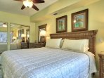 Master Bedroom with a large dresser, 2 end tables, very large 2 door closet and TV