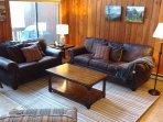 Comfortable living area. Leather couches. Queen sleeper sofa.