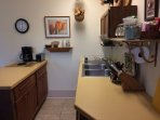 The kitchen is fully equipped. The stove, fridge, and microwave are out of the picture.