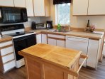 kitchen w dishwasher, garbage disposal, microwave, toaster, coffee maker and range